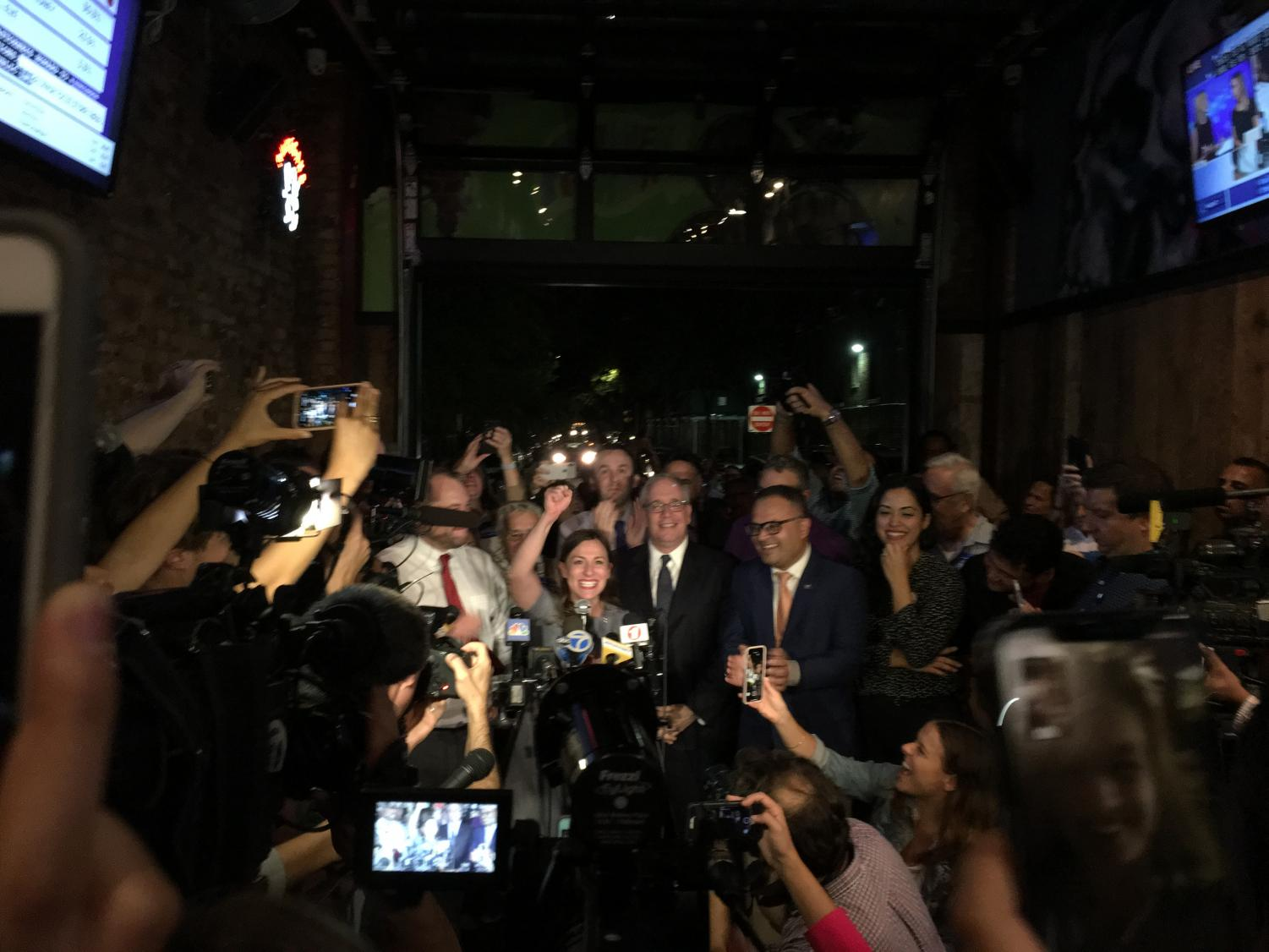 Alessandra Biaggi  celebrates with supporters at the Bronx Alehouse.