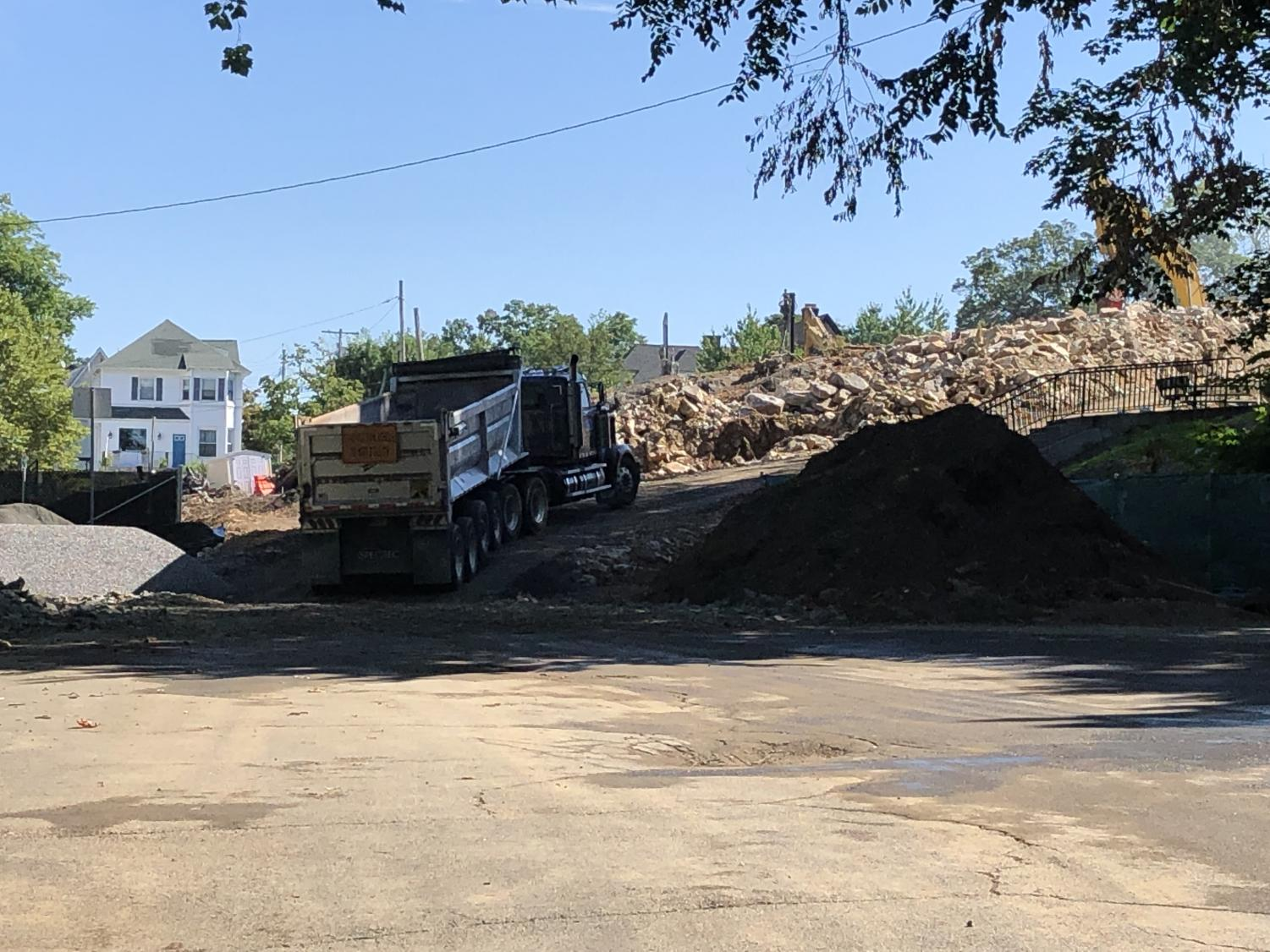 A truck drove past the former lower playground to where site preparation crews were breaking up rocks on the property of Hutchinson School.