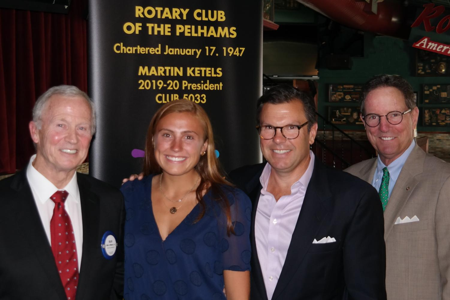 From left, Rotarian Ellis Moore Jr., Charlotte Edmunds; her father, Robert Edmunds, and Rotarian Kevin Falvey.