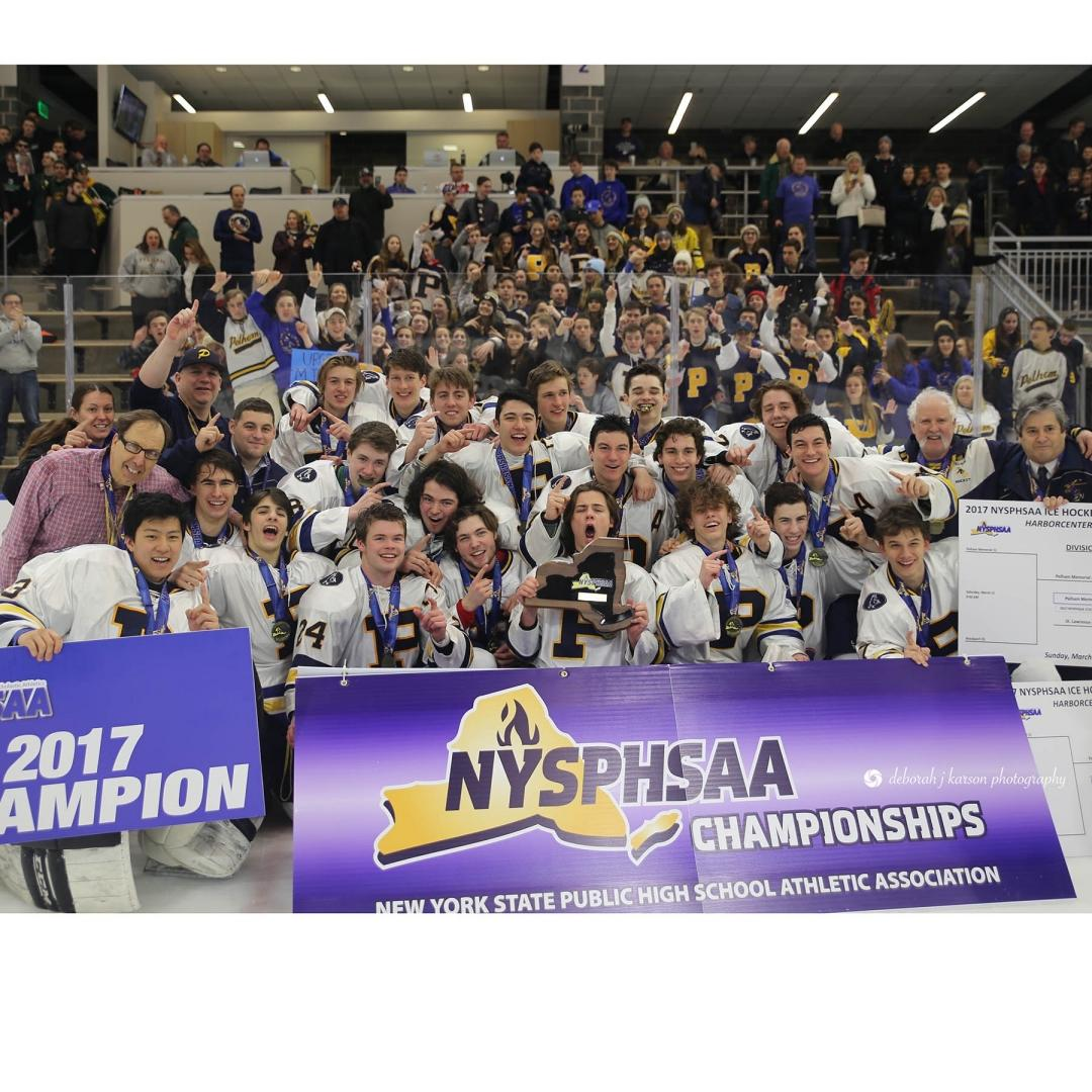 The PMHS 2017 state championship ice hockey team, with Benjamin Hurd dead center with the medal around his neck.