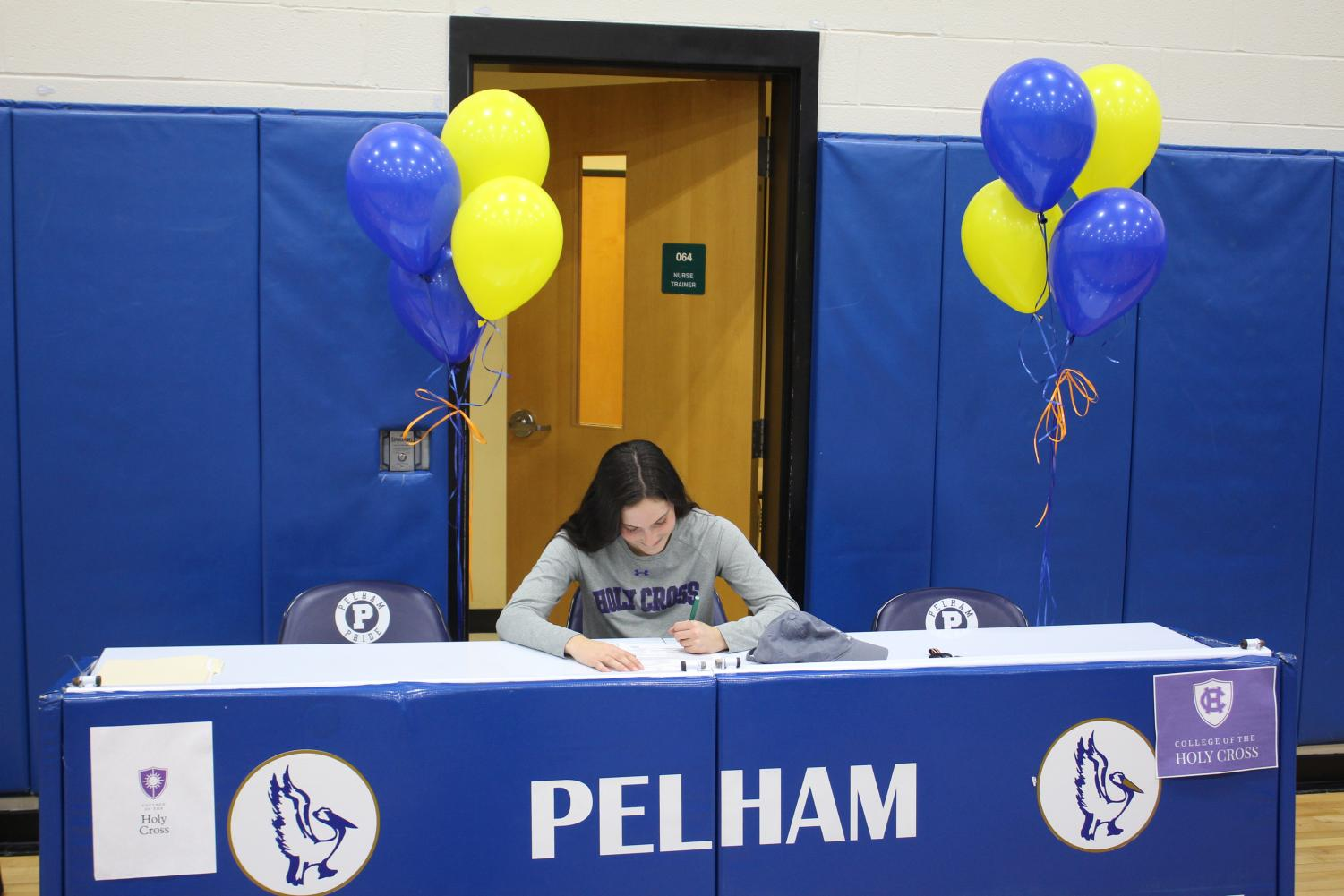Maria Comerford signing letter of intent