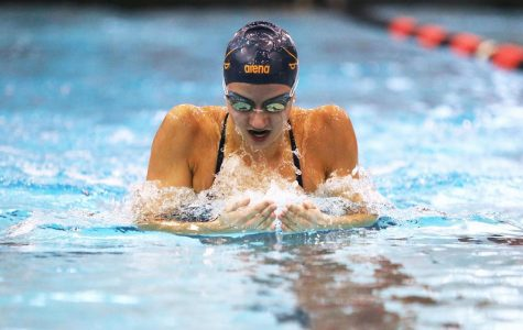 PMHS alumna Douglass dominates swimming records, ACC recognition at UVA