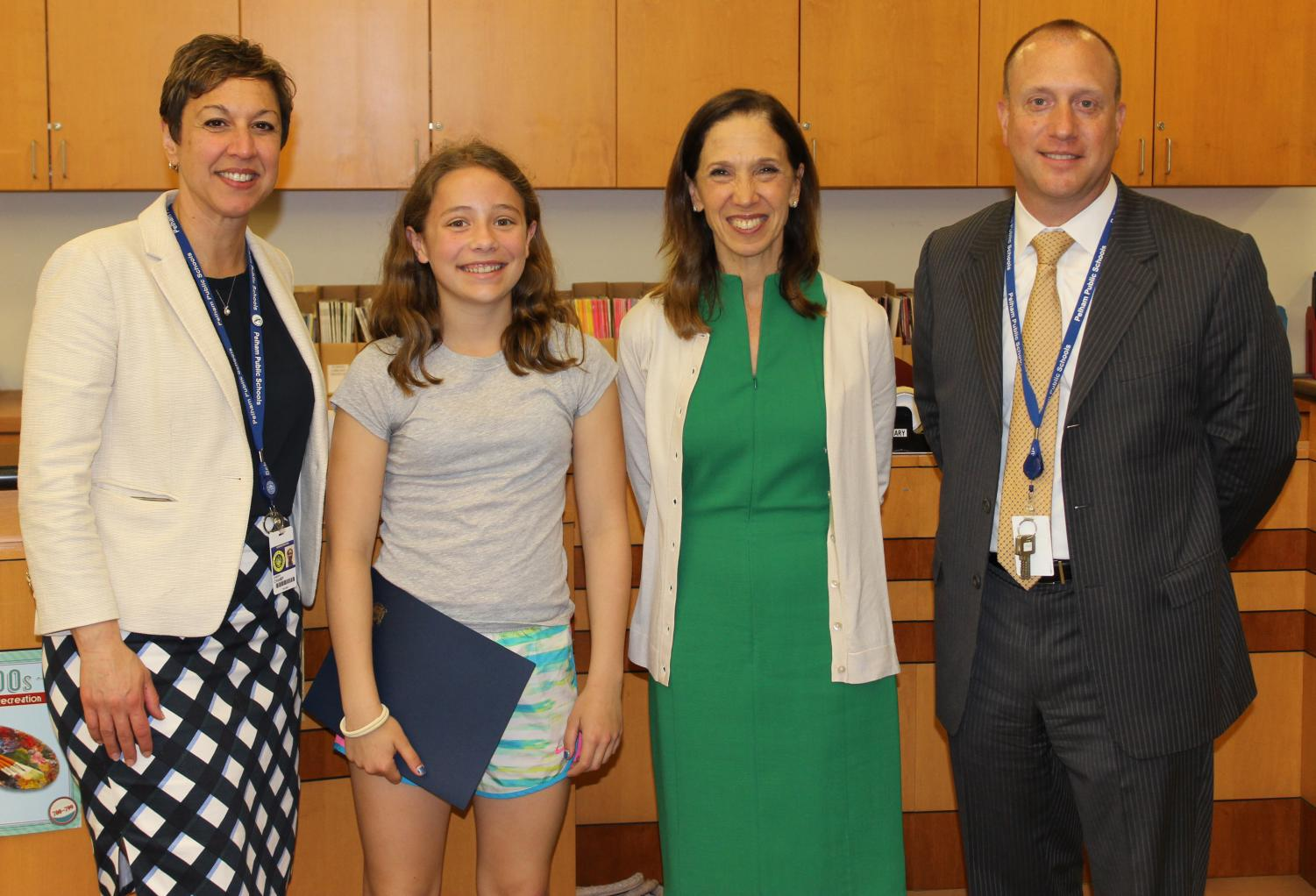 From left, Superintendent Cheryl Champ, Leila Brady (a winner last year), Assemblywoman Amy Paulin and former PMS Principal Dr. Robert Roelle.