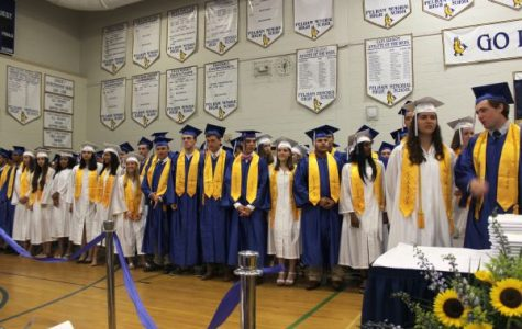 Students stand during the PMHS Graduation ceremony on June 23.