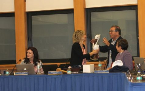 Madeline Smith is given a wooden Pelican by fellow Board Trustee Tom Imperato.