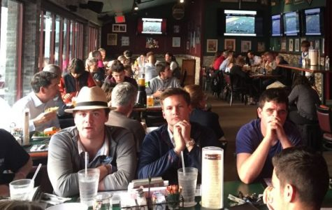 The nearly full downstairs dining room at Rockwells had all screens on the lacrosse state semi-final.