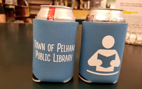 Adults get library drink koozies for signing up for the reading game.