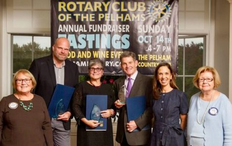 Honorees Clay Bushong, Josephine Catalano and Syd Thayer, holding blue citation folders from Assemblymember Amy Paulin, with Rotary President Lyn Roth Jacobs (far left) and Rotary Tastings Committee Chair Betty Bucher (far right)