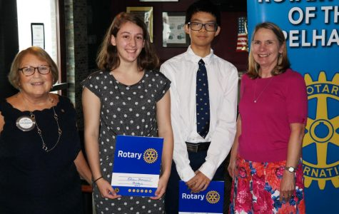 Rotary President Lyn Jacobs, Scholars of the Month Elise Aronson and Richard Che, and PMHS Principal Jeannine Clark.