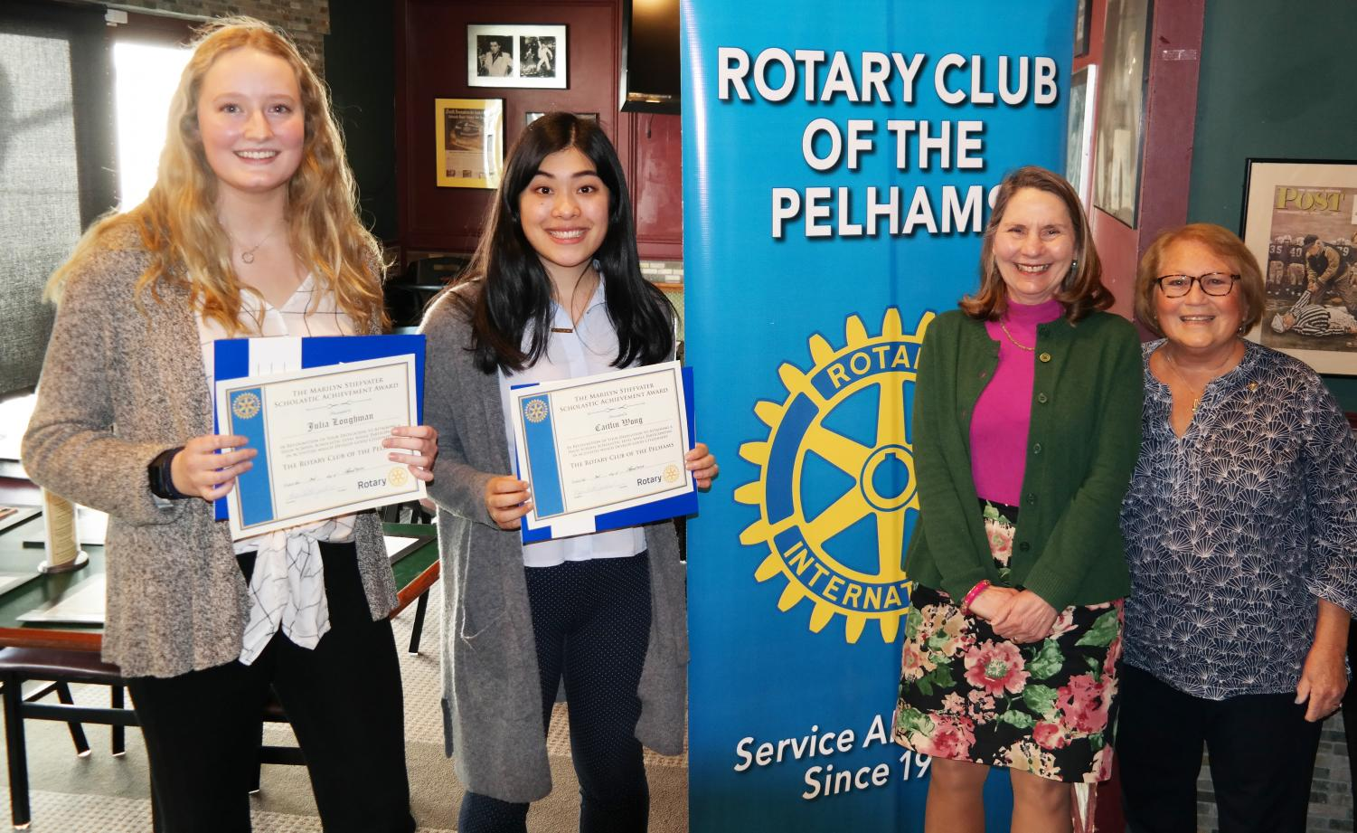 From left, Scholars of the Month Julia Loughman and Caitlin Wong, PMHS Principal Jeannine Clark and Rotary President Lyn Roth-Jacobs.