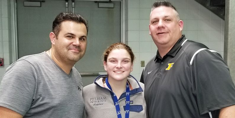 From left, Pelham Memorial High School women's swimming and diving coach Chris Driwinga, Jennifer Bell wearing her Section 1 Diving Championship Gold Medal and PMHS Athletic Director Stephen Luciana.