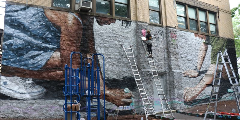 Street Art for Mankind helps students paint mural on Hutchinson School's west wall