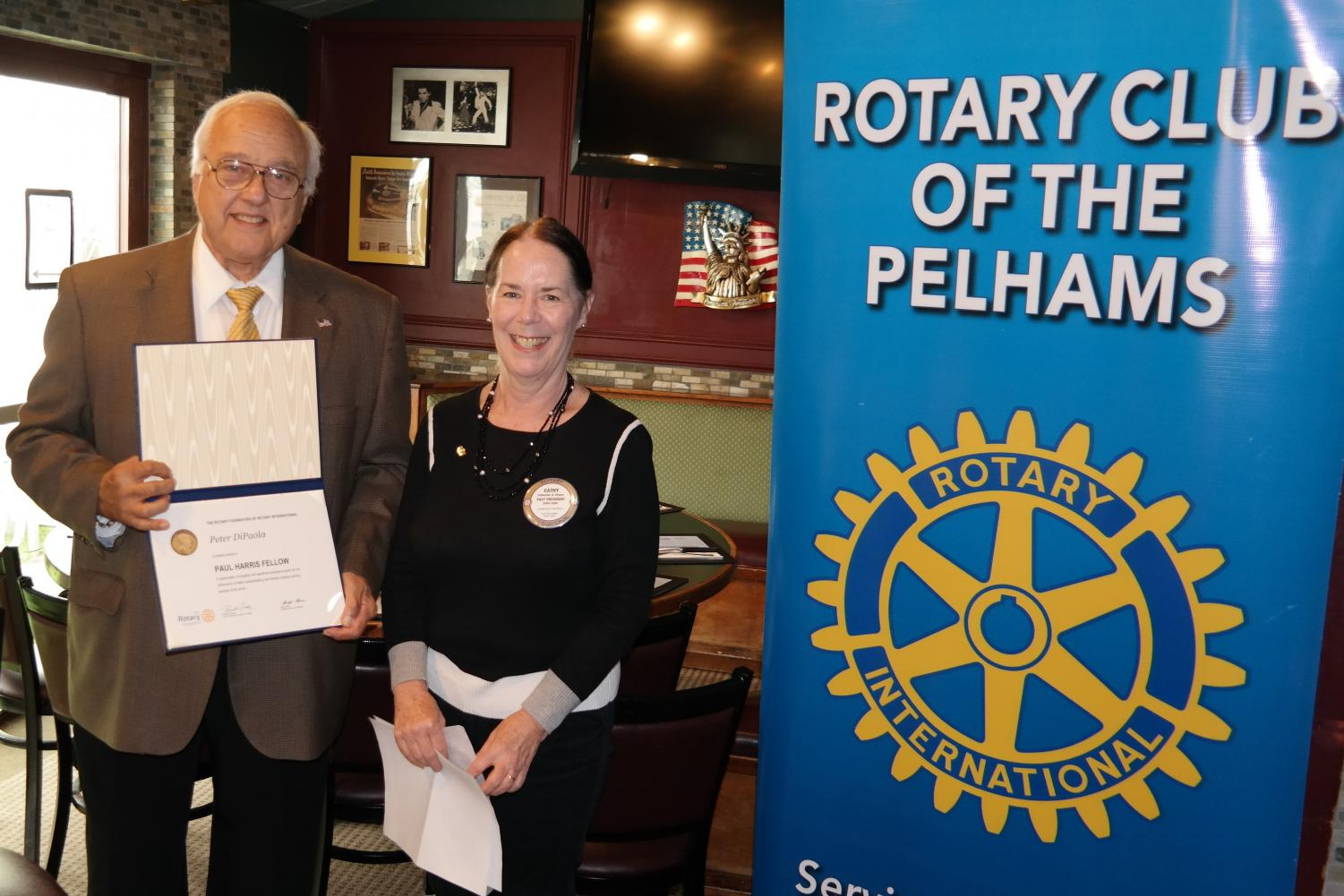 Peter DePaola was presented with a Paul Harris Fellow by former Rotary President Cathy Draper.