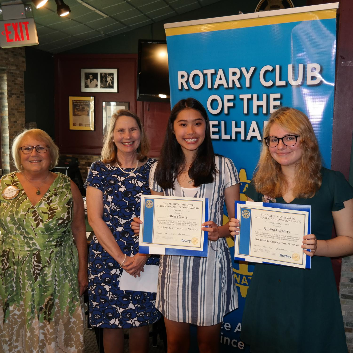 From left, Rotary President Lyn Roth Jacobs, PMHS Principal Jeannine Clark, Scholars of the Month Alyssa Wong and Elizabeth Walters.
