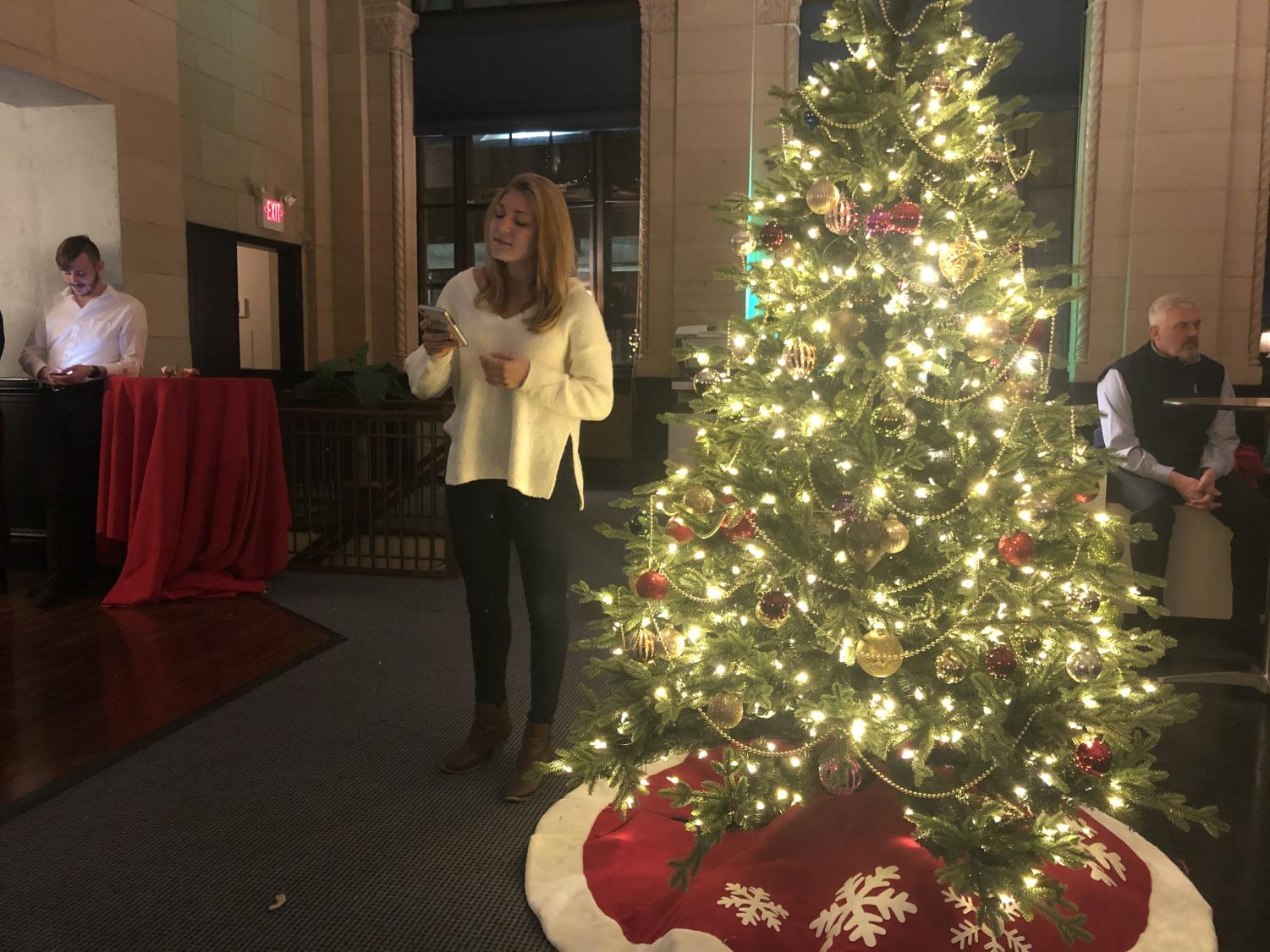 Maggie Solimine sings during Meridian Risk Management's party at its downtown location.