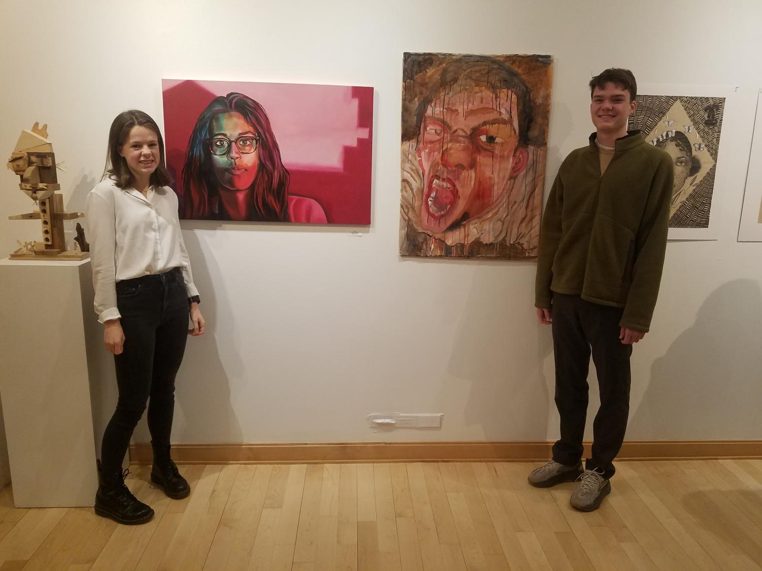 From left, Morgan Sample and Henry Gutch in front of their art.