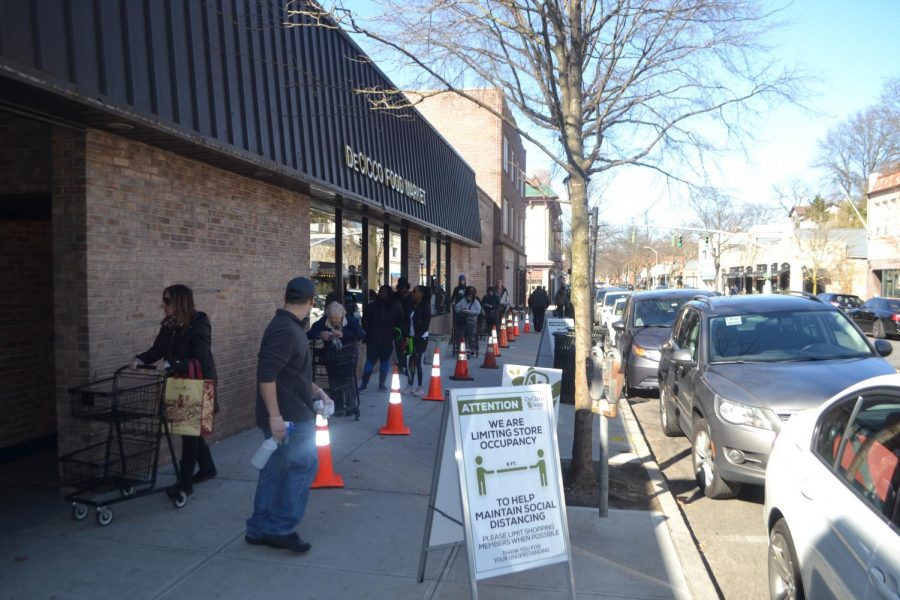 Customers, socially distanced, wait in line outside DeCicco and Sons.