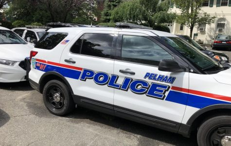 Village of Pelham police vehicles parked next to Town Hall, which houses the department.