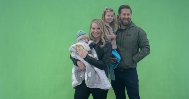 Green screen replaces Santa's lap for holiday photos at popular chamber event