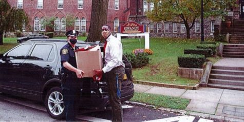A photo from the Pelham Manor report: A village police officer delivers Halloween safety brochures to Siwanoy School.