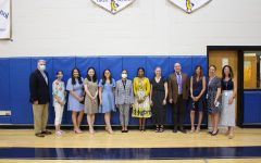 This year's tenure recipients: Jim Hricay, Lisa DiCeglio, Paige Hefter, Yutong (Daisy) He, Samantha Horn, Linda Haynes, Leilani Ruprich, Fran Corelli, Sean Llewellyn and Jeannine Carr with Dr. Cheryl Champ, superintendent of schools, and Jessica DeDomenico, school board president.