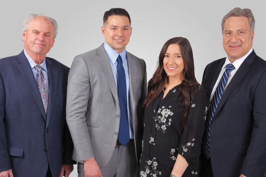 From left, Charles Small, vice president; Paul Lippolis, vice president of energy efficiency; Michelle Parinello, director of marketing, and CEO Carmine Lippolis.