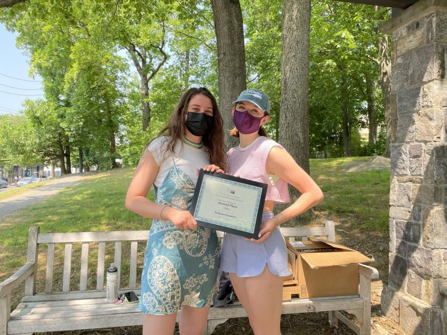 Charlotte Howard (left) received from Examiner Executive Editor Zoe Winburn the certificate for the journalism award she won for a story on last years seniors.