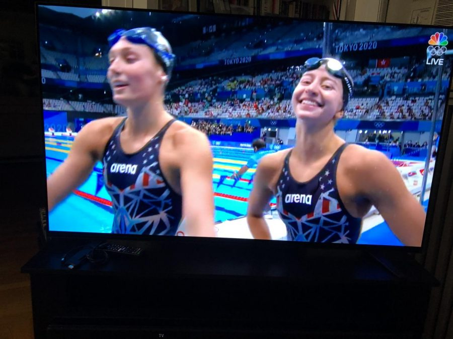 Bronze medalist Kate Douglass (r.) leaves the pool with University of Virginia teammate Alex Walsh, who took silver.