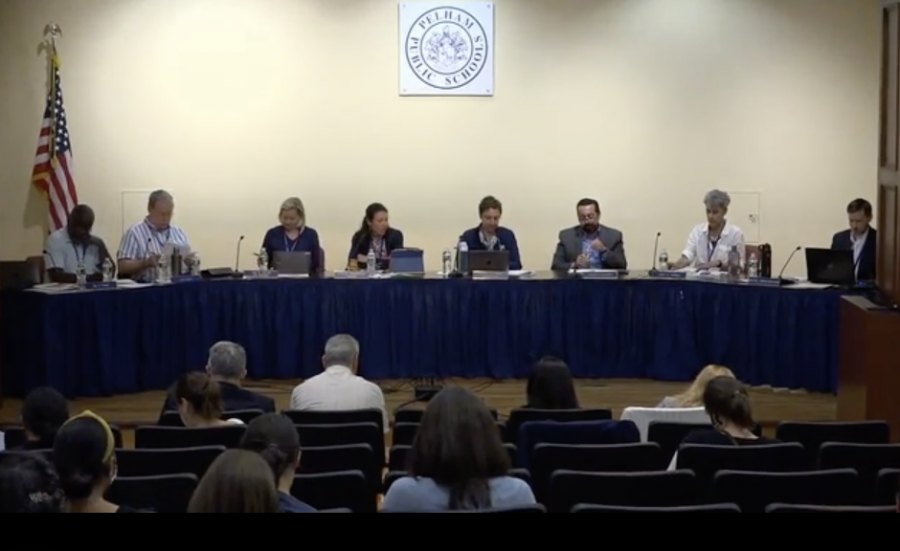 The Pelham school board approved a proposed diversity policy while meeting in Alumni Hall.