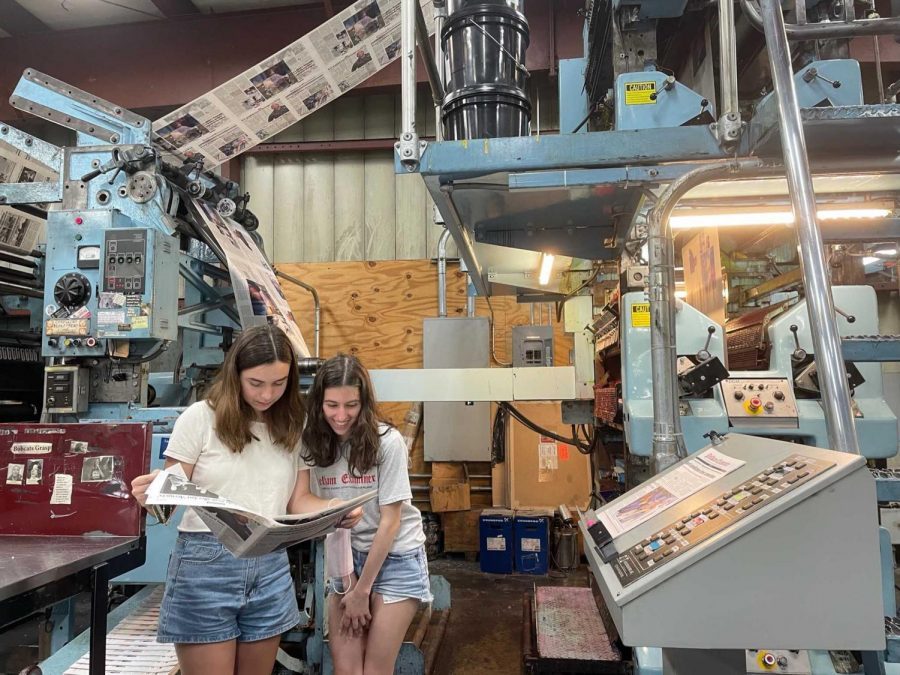 Pelham Examiner Assistant Managing Editor Bella Caruso (left) and Managing Editor Georgia Russello check the first print edition during its press run.