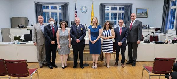 New Pelham Manor Police Chief Thomas Atkins (center) with village board members and administrators.