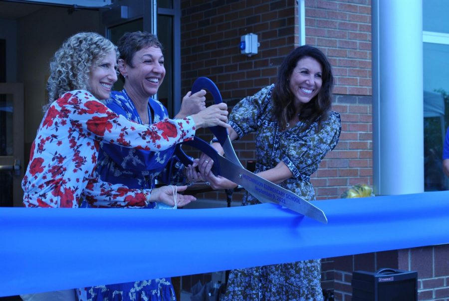 Former Board of Education President Madeline Smith (l.), Superintendent Dr. Cheryl Champ and current Board President Jessica DeDomenico cut the big ribbon.