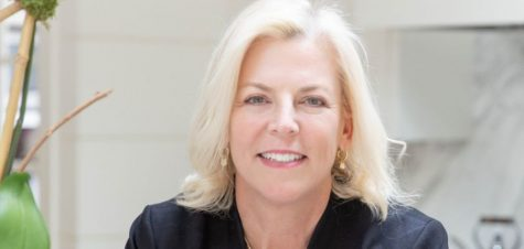 Library Trustee Jennifer Meyer signs as sponsor of Novel Night safe ride home