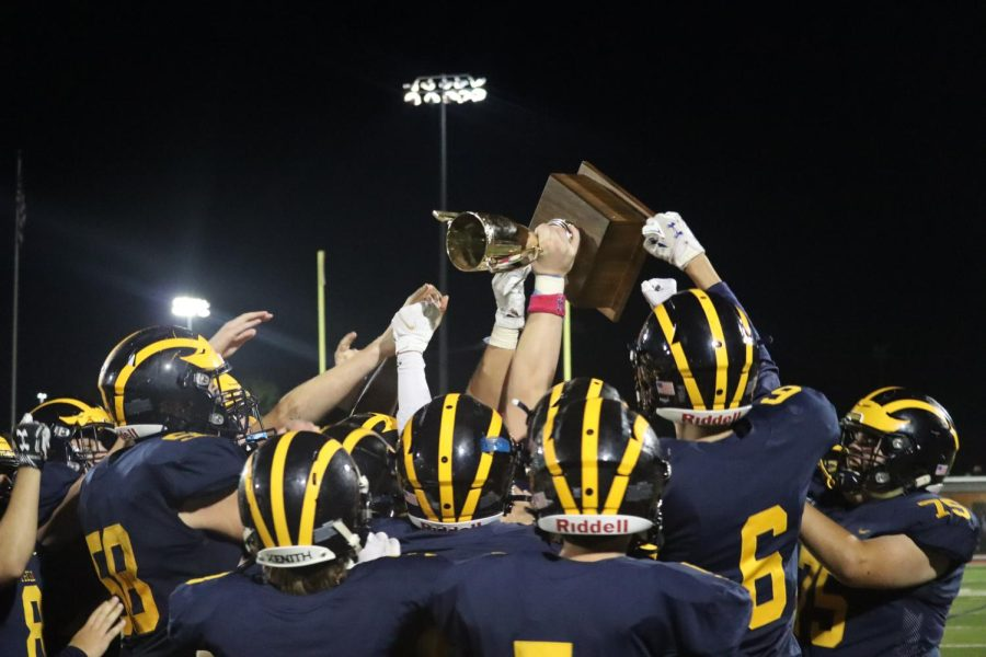 The PMHS football team celebrated with the Colonial Cup.