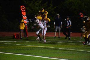 Senior captain Daniel Fredbeck hurdles a defender on a touchdown run.